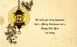 Image of a Christmas greeting card depicting a lantern surrounded by holly