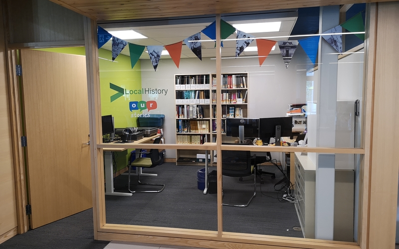 Image of the window looking into the new local history room, located in the Lakeshore Branch of the Innisfil Public Library